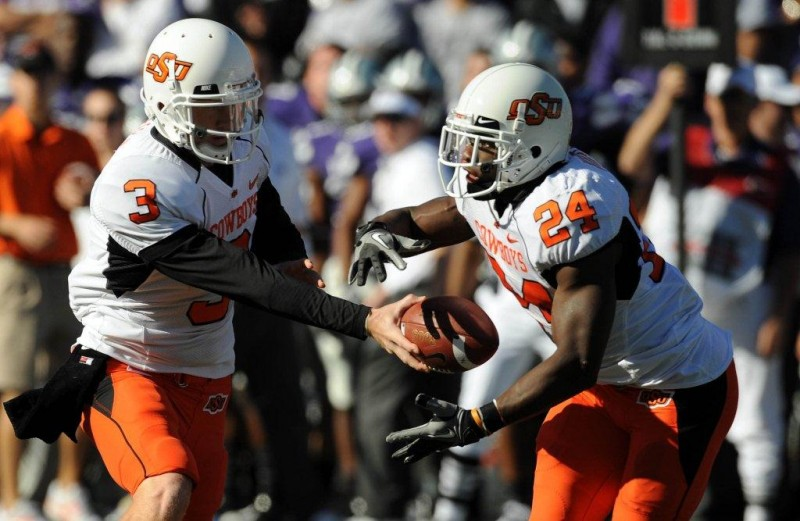 Oct 30 2010 Manhattan KS USA Oklahoma State Cowboys quarterback Brandon Weeden 3 hands off to running back Kendall Hunter 24 in the first half against the Kansas State Wildcats at Bill Snyder Family Stadium. Mandatory Credit John Rieger US PRESSWIRE