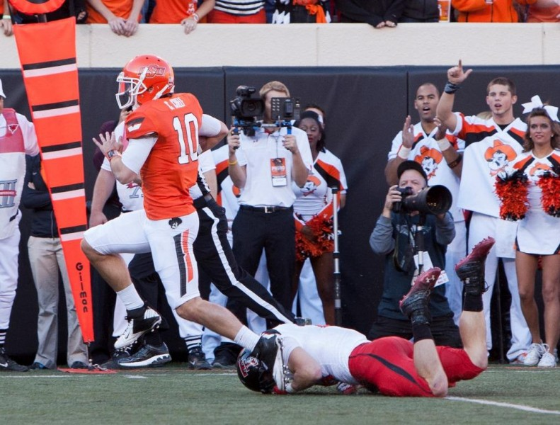 Nov 17 2012 Stillwater OK USA Oklahoma State Cowboys quarterback Clint Chelf 10 runs for yardage during the second quarter against the Texas Tech Red Raiders at Boone Pickens Stadium. Mandatory Credit Richard Rowe US PRESSWIRE