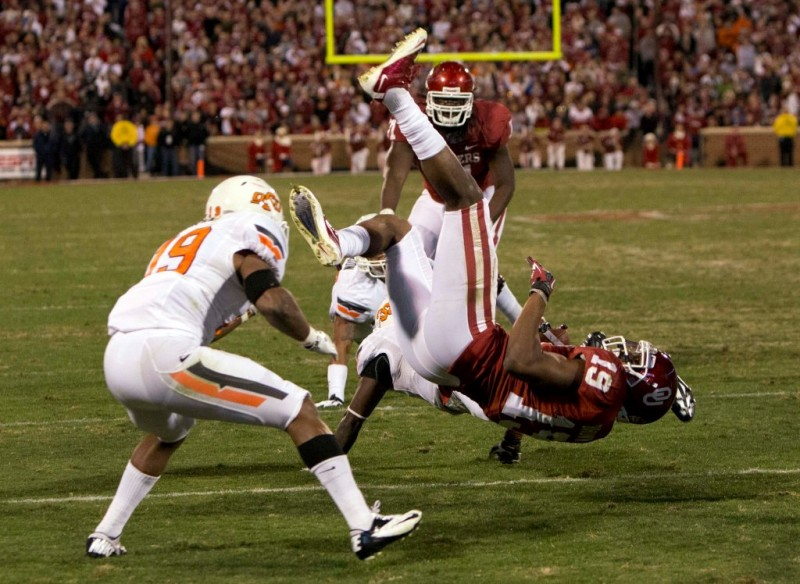 Nov 24 2012 Norman OK USA Oklahoma Sooners wide receiver Justin Brown 19 is tackled by Oklahoma State Cowboys safety Daytawion Lowe 8 during the fourth quarter at Oklahoma Memorial Stadium. Mandatory Credit Richard Rowe US PRESSWIRE