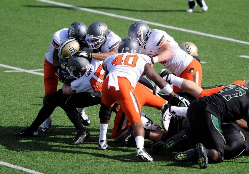 Dec 1 2012 Waco TX USA Baylor Bears running back Glasco Martin 8 is gang tackled by the Oklahoma State Cowboys defense during the first half at Floyd Casey Stadium. Mandatory Credit Jerome Miron US PRESSWIRE