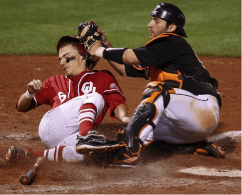 Jared Womack (OSU) tags out Eric Ross (OU) in a 2011 Bedlam baseball game. Photo courtesy of The Oklahoman.