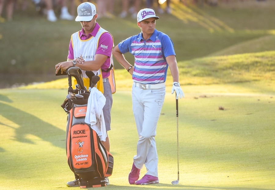 PONTE VEDRA BEACH, FL - MAY 10:  Rickie Fowler waits to play from the 16th hole fairway with his caddie Joe Skovron during a playoff in the final round of THE PLAYERS Championship on THE PLAYERS Stadium Course at TPC Sawgrass on May 10, 2015 in Ponte Vedra Beach, Florida. (Photo by Chris Condon/PGA TOUR)