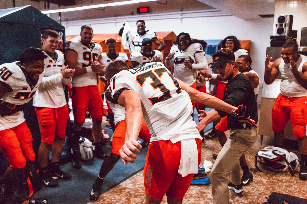 """<div><p>This is amazing. </p> <p>The post <a rel=""""nofollow"""" href=""""https://pistolsfiringblog.com/mike-gundy-served-as-hype-man-as-cale-cabbiness-danced-after-osus-win-saturday/"""">Mike Gundy Served as Hype Man for Cale Cabbiness as he Danced After OSU's Win Saturday</a> appeared first on <a rel=""""nofollow"""" href=""""https://pistolsfiringblog.com/"""">Pistols Firing</a>.</p></div>"""